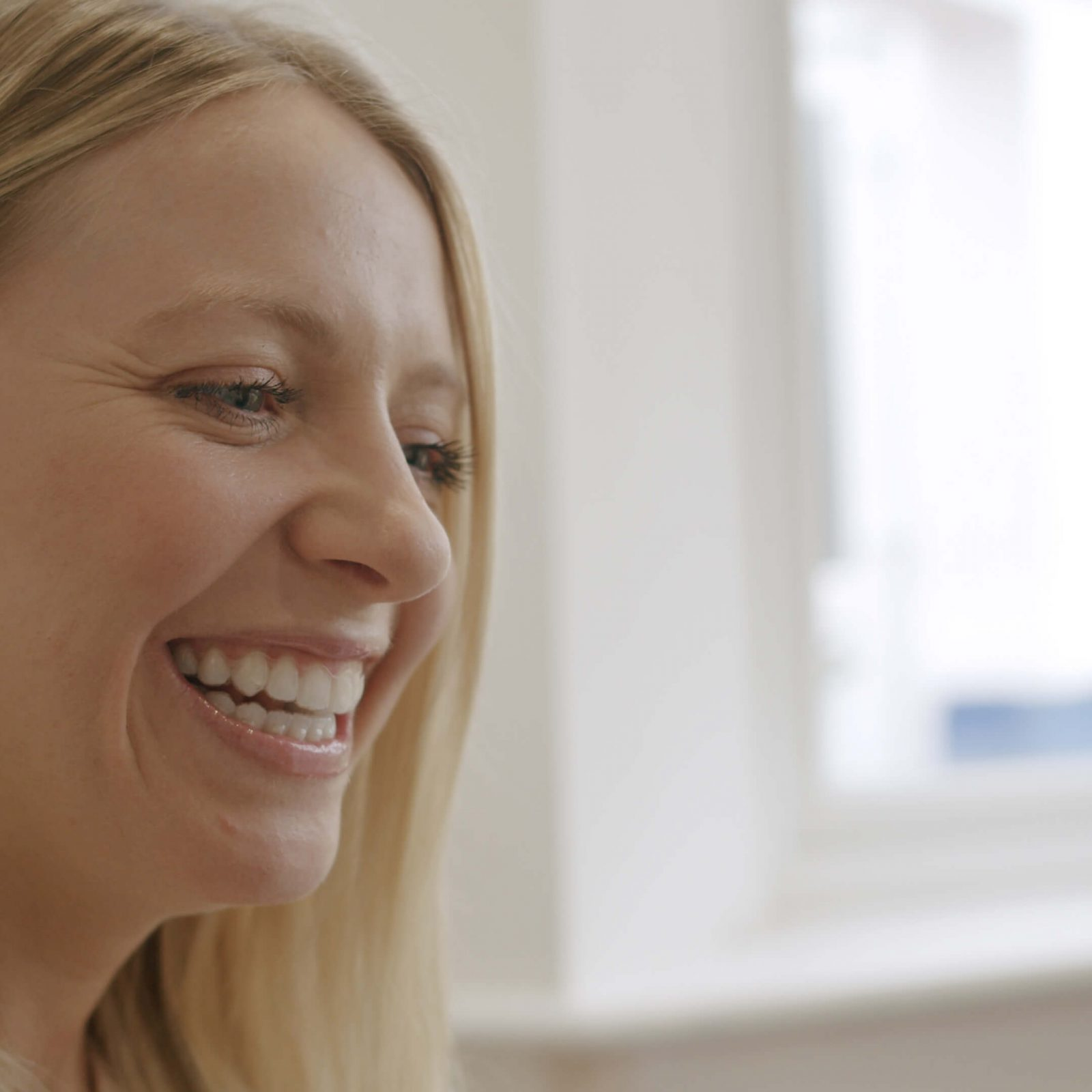 Photo of Rachel Smiling with Invisalign in